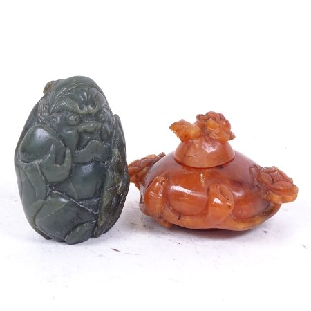 A Chinese carved and polished jadeite figure, and a Chinese carnelian pot and cover, height 5.5cm (