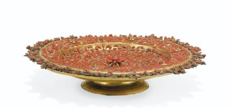 AN ITALIAN (TRAPANI) GILT-COPPER, WHITE, GREEN AND BLUE ENAMEL AND CORAL-MOUNTED SALVER  CIRCA 1720