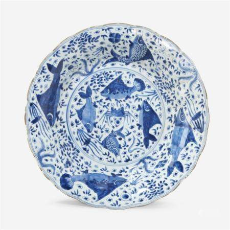 """A large Chinese blue and white porcelain """"Fishes"""" lobed dish, Kangxi period"""