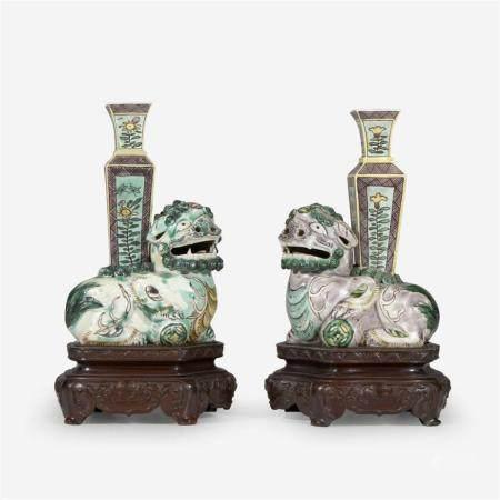 "An associated pair of small Chinese famille verte ""Buddhist Lion"" joss stick holders, Kangxi period"