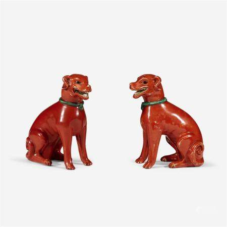 A pair of Chinese iron-red glazed porcelain figures of dogs,