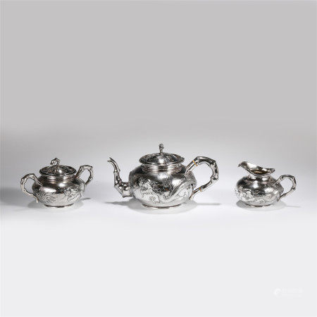 A SET OF CHINESE THREE EXPORT SILVERWARE TEA SETS