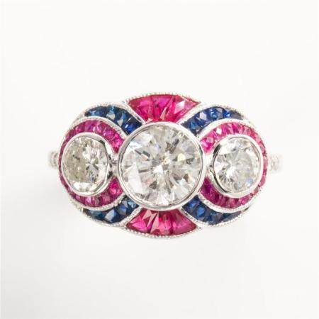A diamond, ruby, sapphire and platinum ring