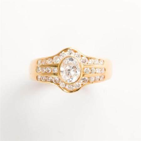 A diamond and eighteen karat gold ring