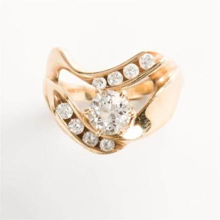 A diamond and fourteen karat gold ring