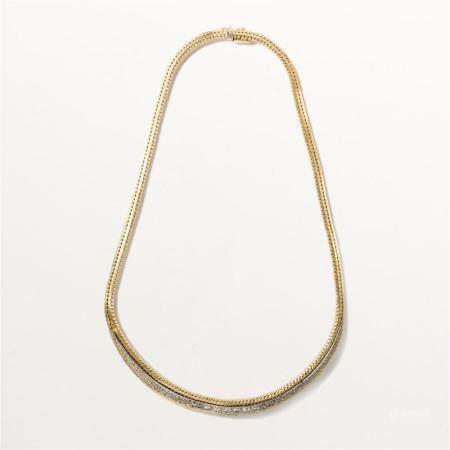 A diamond and fourteen karat gold necklace