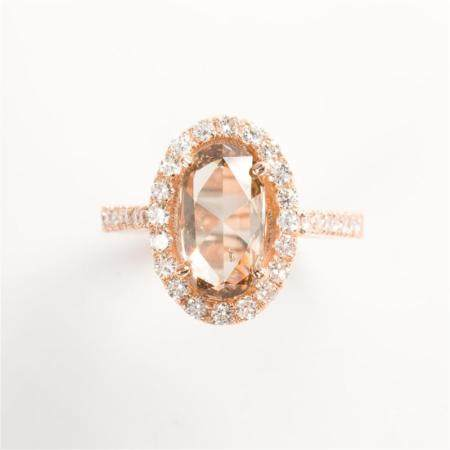 A cognac and colorless diamond and eighteen karat rose gold ring