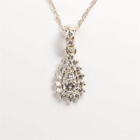 A diamond and fourteen karat white gold pendant necklace