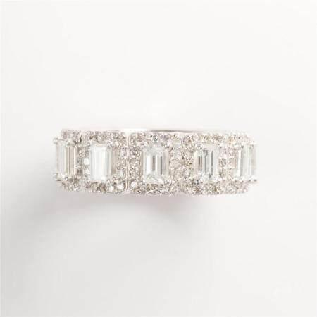 A diamond and eighteen karat white gold band ring