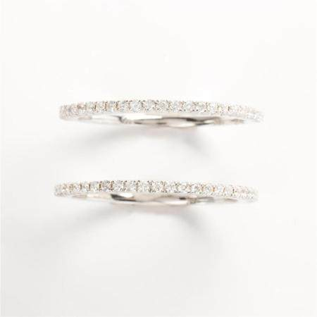 A pair of diamond and eighteen karat white gold band rings