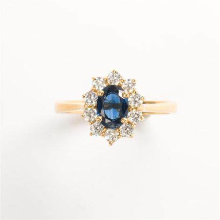 A sapphire, diamond and eighteen karat gold ring