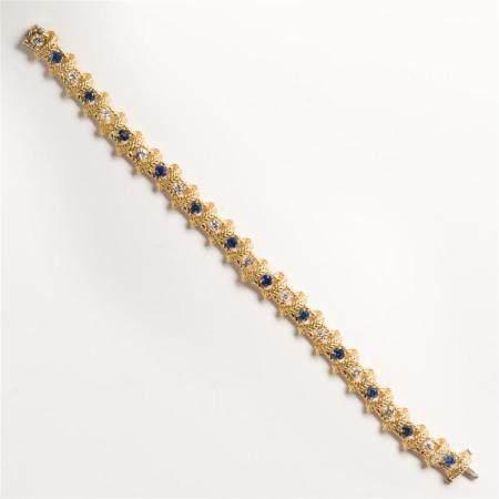 A diamond, sapphire and eighteen karat gold bracelet