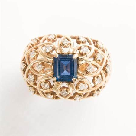 A sapphire, diamond and fourteen karat gold ring
