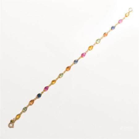 A sapphire, ruby and eighteen karat gold bracelet