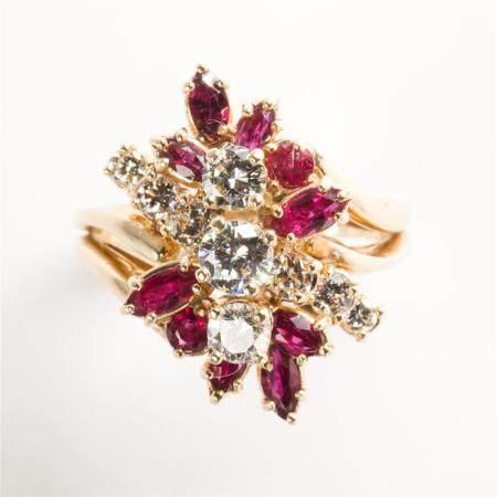 A diamond, ruby and fourteen karat gold ring
