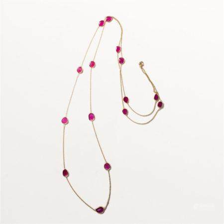 A ruby and fourteen karat gold necklace