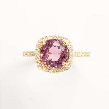 A pink *SPINEL*, diamond and eighteen karat gold ring