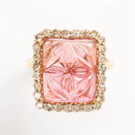 A tourmaline, diamond and fourteen karat gold ring