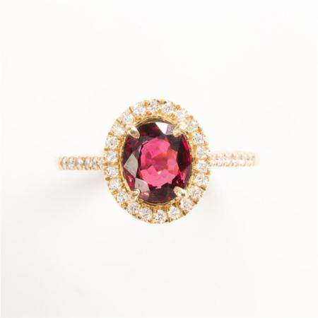 A red spinel, diamond and fourteen karat gold ring