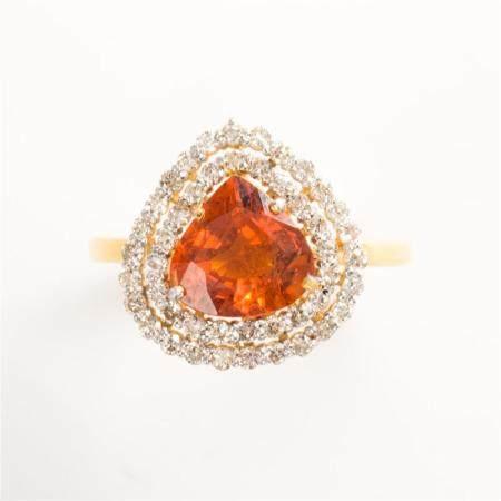 A spessartine garnet, diamond and eighteen karat gold ring