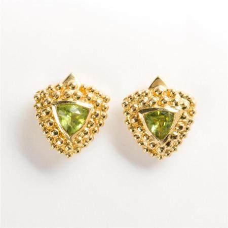 A pair of peridot and fourteen karat gold earrings