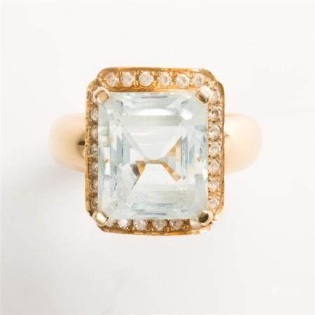 An aquamarine, diamond and eighteen karat gold ring