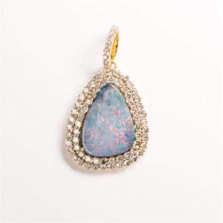 A black opal, diamond and eighteen karat gold pendant