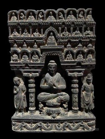 AN ASIAN STYLE VINTAGE  BUDDHA THEME STONE STATUE