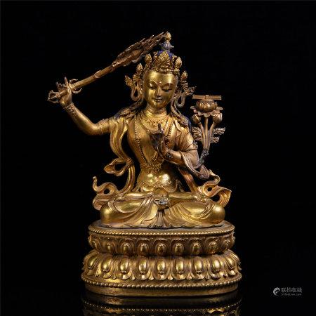 A GILT BRONZE MANJUSHRI BUDDHA STATUE
