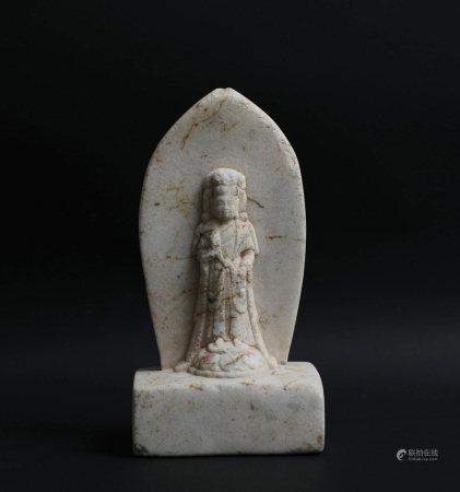 A SMALL STONE BUDDHA STATUE