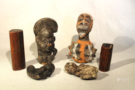 A group of African pottery including Cameroon items, comprising two smoking pipes, 18cm and 10 cm