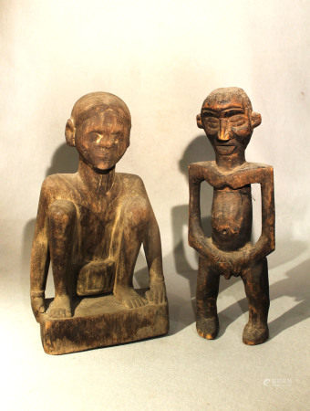 A Naga carved wood squatting figure, and a Cameroon standing figure, both mid 20th century, both