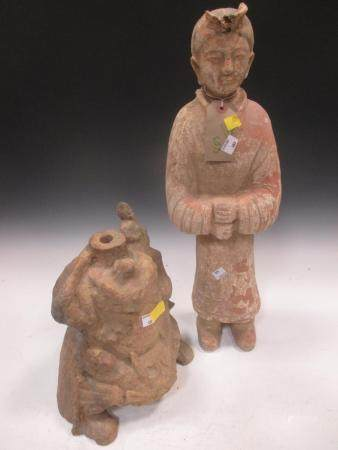 Two Chinese painted pottery figures, a standing figure of a guard, Han type, 57cm high; and a