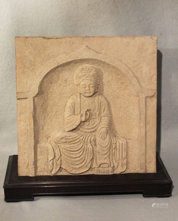 A Chinese red pottery panel in relief with seated Bodhisattva, within an arch, in 6th-7th century