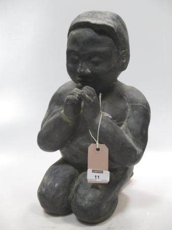 A Chinese black glazed porcellanous figure of a kneeling boy child, 20th century, 35cm high