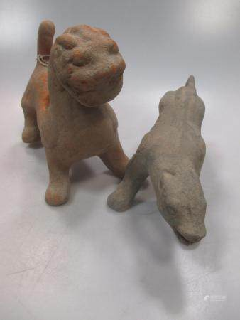 A Chinese grey pottery prowling dog and a red pottery chimera, both probably Han Dynasty (206 BC -