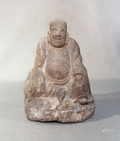 A Chinese cream stone seated figure of a smiling Putai, perhaps late Ming Dynasty, 21cm high