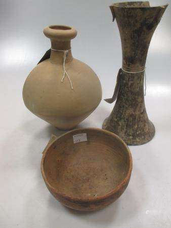 A group of three Chinese pottery vessels, Neolithic type, comprising Gu vase 23.5cm high; hemi-