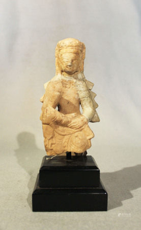 A Chinese white marble seated Guanyin, in 6th/7th Century style, with rudimentary repair, 14.5cm