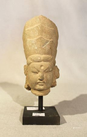 A Chinese grey stone head of a Bodhisattva with three crowns, in Tang Dynasty style, 14.5cm high