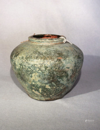 A Chinese green glazed pottery, shouldered vase, probably Han Dynasty, 19cm high