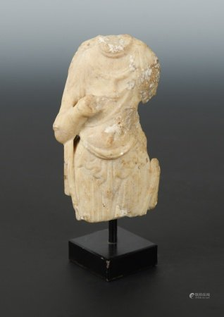 A Chinese white marble fragmentary torso of a Buddhist deity, in Sui Dynasty style, 14cm high