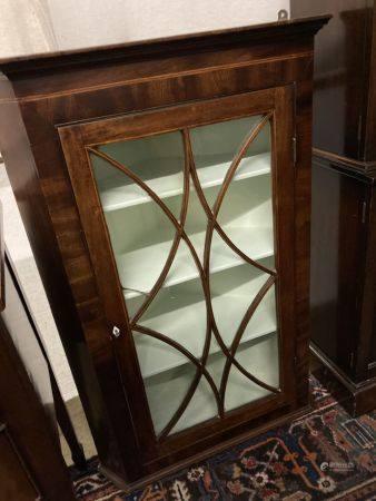 A George III mahogany hanging corner cupboard with glazed door, width 74cm, depth 39cm, height