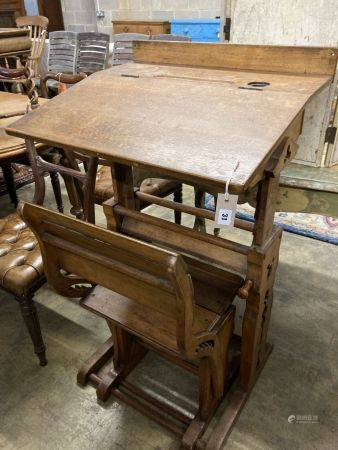 A 19th century Continental oak metamorphic rise and fall student's desk together with a matching