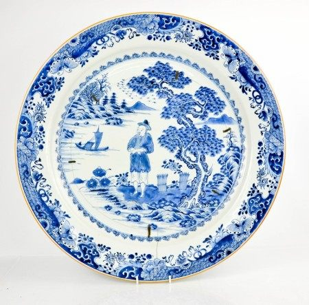 A large Chinese blue and white 19th century charger, depicting figure in landscape. A/F