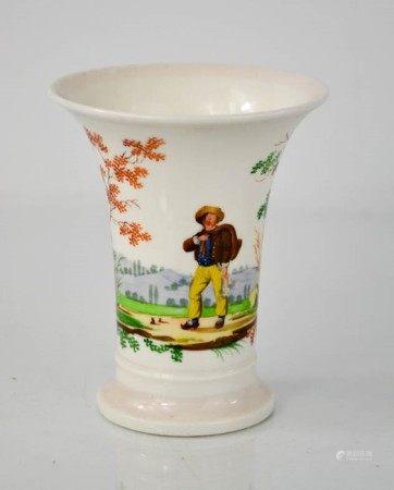 A 19th century bud vase, depicting figure in landscape.