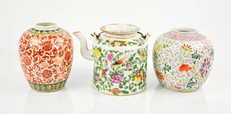 A late 19th century Chinese ceramic tea pot, enamelled with flowers and birds, together with two