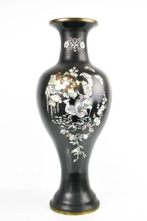 A Chinese black enamel and mother of pearl inlaid vase, depicting peacocks and flowers, 60cm high.