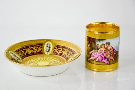 A fine early 19th century Vienna porcelain coffee can and saucer, hand painted to depict courting