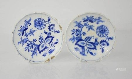 A pair of blue and white EWM&Co Meissen dishes depicting flowers, 14cm diameter. A/F